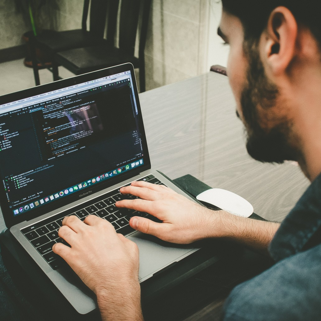 Man working on laptop at office